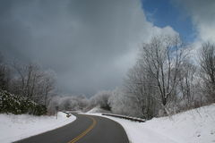 Snow and road. Snow and a curving road, Cherohala skyway at about 5000 feet in appalachia, North Carolina Stock Image