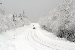 Snow on the road. Mountain road after a fresh snowfall stock images