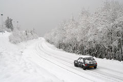 Snow on the road. Mountain road after a fresh snowfall stock photography