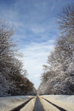 Snow Road. Blue sky royalty free stock photography