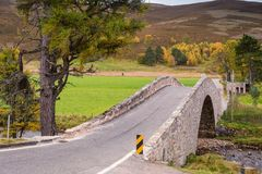 Snow Road over Gairnshiel Bridge. The Snow Road or Old Military Road is a scenic drive through the Cairngorms National Park, it crosses the River Gairn on royalty free stock images