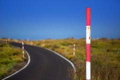 Snow road poles in high mountain blue sky Stock Image