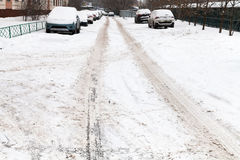 Snow road in residential district Stock Photo
