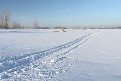 Snow road on the river Royalty Free Stock Photos