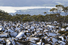 Snow On Rock Faces Australia. Snow covering one side of rocks down the side of a mountain looking a bit like penguins Royalty Free Stock Images