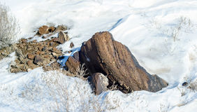 Snow and rock. Stock Images