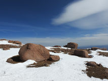 Snow and rocks with blue sky. On top of Pikes Peak Royalty Free Stock Photography