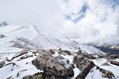 Snow and rocks on the mountain pass in Caucasus Stock Images