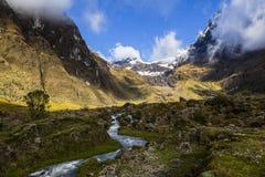 Snow, rocks and river in El Altar volcano Stock Photo