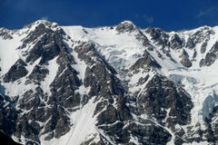 Snow and rocky peaks landscape Royalty Free Stock Image