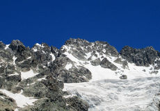 Snow and rocky peaks landscape Royalty Free Stock Images