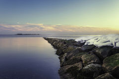 Snow on a Rocky Pier Royalty Free Stock Photo