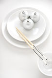 Snow rolls. A creative plate in a japanese sushi restaurant menu decorated with Christmas balls and chopsticks royalty free stock image