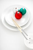 Snow rolls. A creative plate in a japanese sushi restaurant menu decorated with Christmas balls and chopsticks stock images
