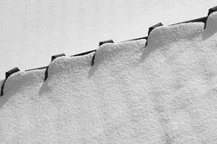 Snow roof. In black and white royalty free stock photo