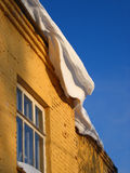 Snow on a roof royalty free stock photo