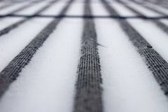 Snow on the roof of asbestos. Single focus Royalty Free Stock Photos