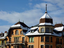 Snow on roof of a colored building Royalty Free Stock Photo