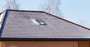 Snow on the roof of the house in winter.  royalty free stock images