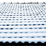 Snow on roof tiles Stock Images