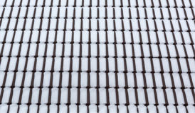 Snow on roof tiles. Stock Images