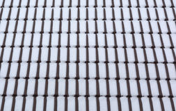 Snow on roof tiles. Royalty Free Stock Photography