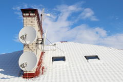 Snow on a roof. Winter, Snow, Aerials on a roof Royalty Free Stock Photos