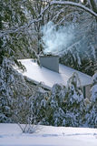 Snow On the Rooftop, Fire Inside Royalty Free Stock Photo