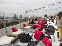 In the snow on a rooftop restaurant Royalty Free Stock Photos