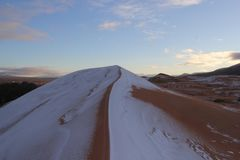 Snow in desert sahara. Snow on the sahara dune, changeable cimaliques; wonderful views of the dunes stock images