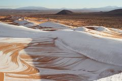 Snow in desert sahara. Snow on the sahara dune, changeable cimaliques; wonderful views of the dunes Royalty Free Stock Photos