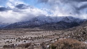 Snow in the Sandia Mountains near Albuquerque. View from the foothills of the Sandia mountains after recent winter snow showers. The eastern portion of Stock Photo
