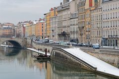 Snow on the Saone river banks in Lyon. LYON, FRANCE, March 1, 2018 : Saone river banks as a cold spell rages in all Europe and the Capital of Gallia is under the Royalty Free Stock Photos