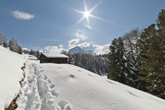 Snow, Sasslong and Barn in the Dolomites Royalty Free Stock Image