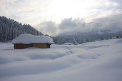 Snow-scape with Hut in Kashmir, India. View in winter of the snow covered landscape depicting a hut in Gulmarg, Kashmir Royalty Free Stock Photography