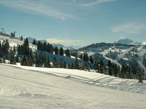 Snow Scene. View of a snow covered skiing mountain in the Alps Royalty Free Stock Image