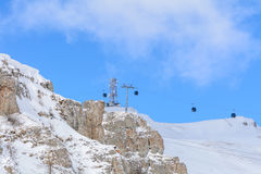 Snow scene from Carpathian Mountains, Romania. Cable cars over royalty free stock photos