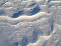 Snow sculpted by wind. In an abstract pattern Royalty Free Stock Photos