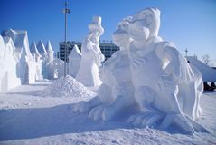 Snow sculpture of two chickens. In Russia Royalty Free Stock Photography