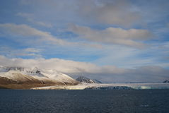 Snow and sea in svalbard islands Royalty Free Stock Photo