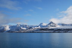 Snow and sea in svalbard islands Stock Photos
