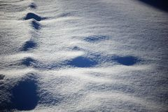 Snow and shadows. texture background snow surface the snow royalty free stock images