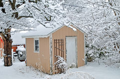 Snow on the shed. Image of a storage shed in winter stock image