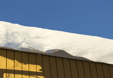 Snow Sheet Hanging from Roof Royalty Free Stock Photos