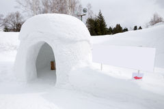 Snow shelter with blank sign Royalty Free Stock Image