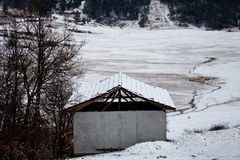 Snow and shelter near forest Stock Photography