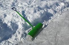 Snow shovel. Used for clearing ice on outdoor skating rink stock images
