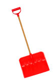 Snow shovel. A isolated orange snow shovel royalty free stock image