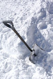 Snow shovel in a deep snow Stock Images