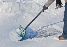 Snow Shovel pushing snow Stock Photography
